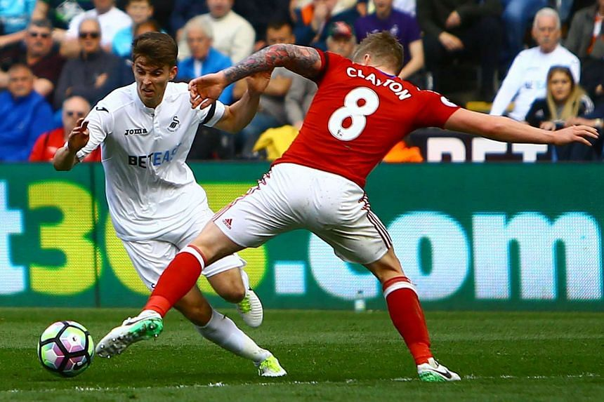 Swansea City midfielder Tom Carroll (left) in a match against Middlesbrough on April 2.