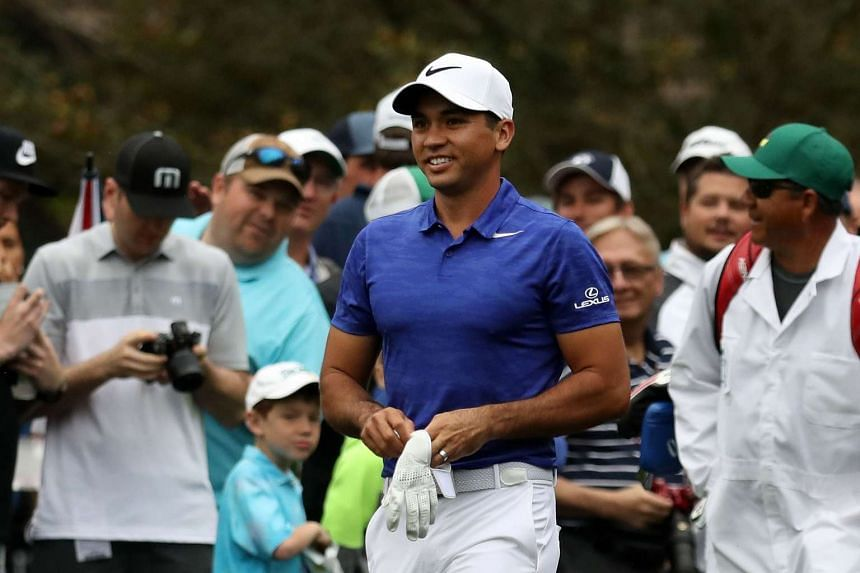 Jason Day of Australia reacts during a practice round prior to the start of the 2017 Masters, April 3, 2017.