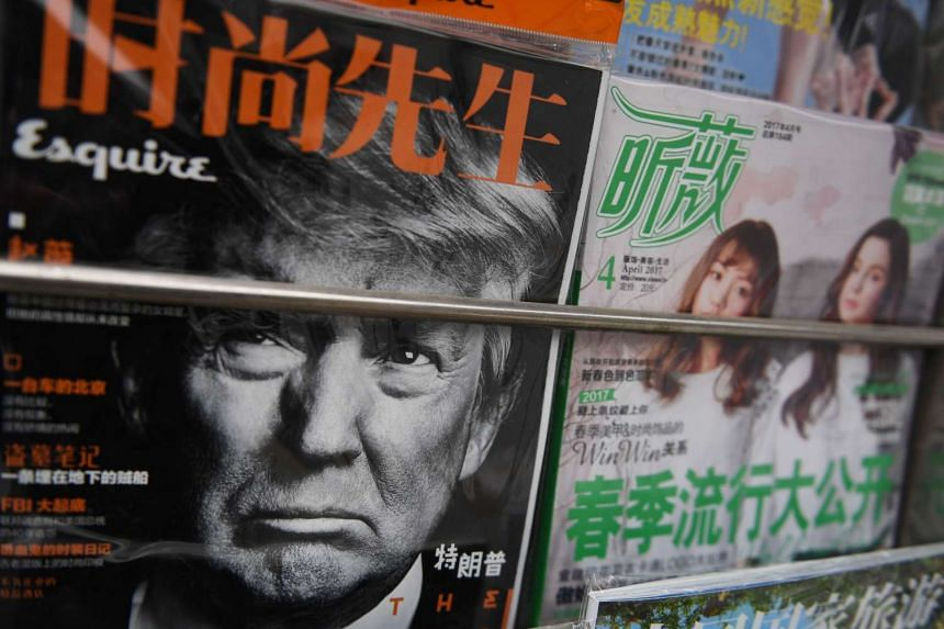 A magazine featuring a front page photo of US President Donald Trump is seen at a news stand in Beijing on April 4, 2017.