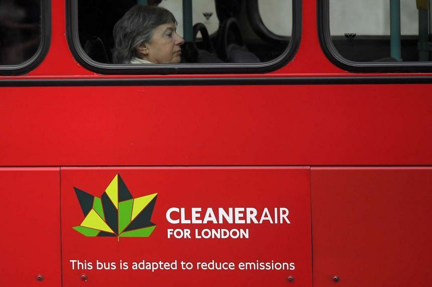 A passenger riding on a public bus on the day that Mayor of London Sadiq Khan outlined plans to place a levy on the most polluting vehicles in London, Britain, on April 4, 2017.
