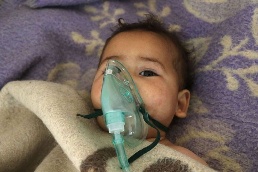 A Syrian child receives treatment at a hospital in Maaret al-Noman following a suspected chemical attack in Idlib province.
