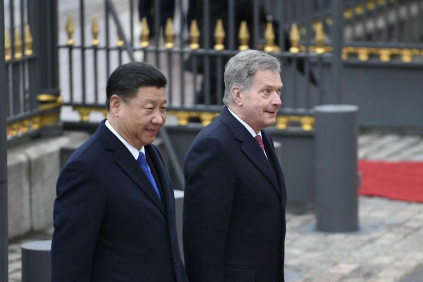 Chinese President Xi Jinping (left) is welcomed by Finnish President Sauli Niinistö during an official ceremony in front of the Presidential Palace in Helsinki, Finland, on April 5, 2017.