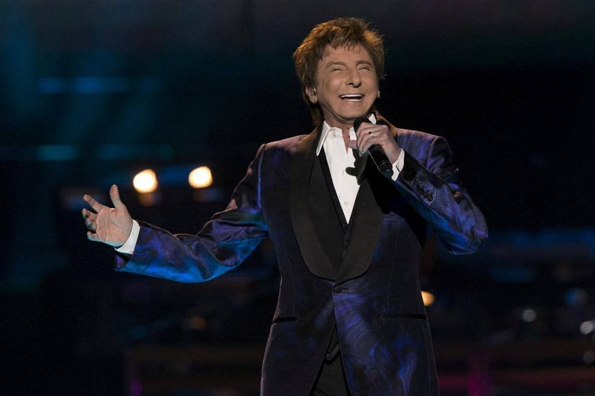 Barry Manilow performs during his One Last Time! Tour at Staples Center in Los Angeles on April 14, 2015.