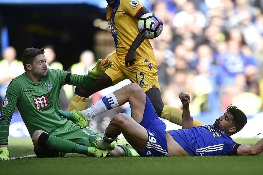 Chelsea's Diego Costa getting stuck in against Palace goalkeeper Wayne Hennessey in the Blues' shock 1-2 loss on Saturday. The Brazil-born Spain forward wants to reignite his earlier dominant form, having scored 13 league goals until Christmas but on
