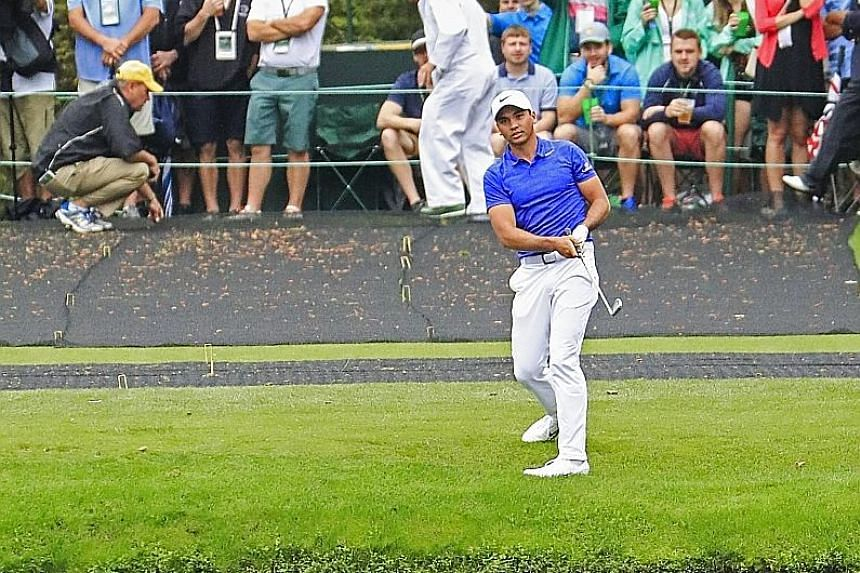Jason Day having fun during practice for the Masters by skipping a ball across the water hazard on the 16th hole. After cancer surgery, his mother could be well enough to be at Augusta for the weekend.