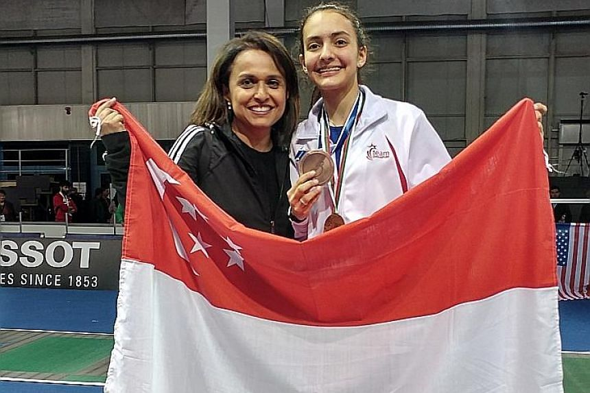 National fencer Amita Berthier celebrating her foil bronze at the World Junior and Cadet Championships in Plovdiv, Bulgaria, with her mother Uma. She trains full-time under coach Ralf Bissdorf in Boston.