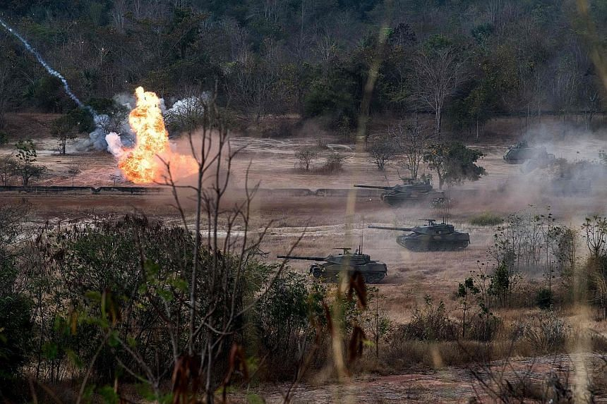 The Thai and US military engaging in a live-fire exercise in north-eastern Thailand on Feb 24. Thailand's Cabinet yesterday approved the $81-million purchase of 10 Chinese tanks to replace US-made rolling stock.
