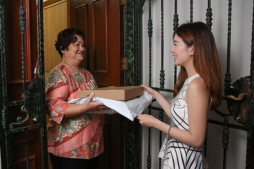 """The Hougang flat of """"parker"""" Mary Ho, a housewife, is part of local start-up Park N Parcel's network of residential collection points from which consumers such as Ms Joy Tan can collect their parcels."""