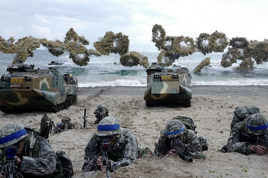 South Korean marines taking part in the annual US-South Korea joint Foal Eagle exercises. Pyongyang has accused the US of holding joint military drills with South Korea and Japan as a dress rehearsal for invasion.