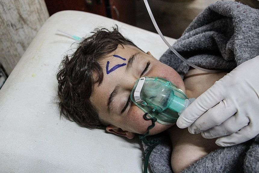 A Syrian child being treated at a field hospital in Saraqib, Idlib province, after an alleged chemical attack. The latest violence came as the EU and UN hosted a conference in Brussels on Syria.