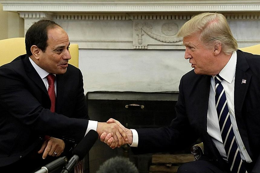 Mr Donald Trump and Mr Abdel Fattah al-Sisi in the Oval Office of the White House in Washington on Monday. A joint statement said the two leaders agreed Islamist militants could not be defeated solely by military force.