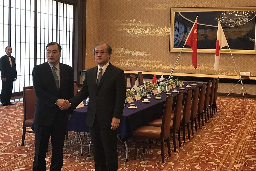 Mr Kong Xuanyou (left) and Mr Takeo Akiba discussed the North Korean nuclear and ballistic missile threat and the political situation in South Korea, among other things, during their meeting at the Iikura Guest House in Tokyo yesterday.