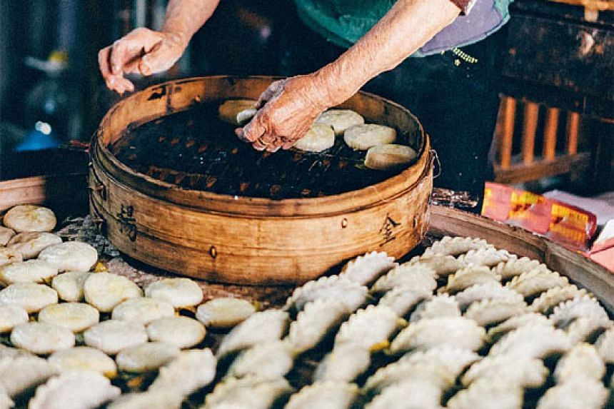 Qingtuan, or green dumplings, are made of glutinous rice mixed with Chinese mugwort leaves and are usually filled with sweet red bean paste.
