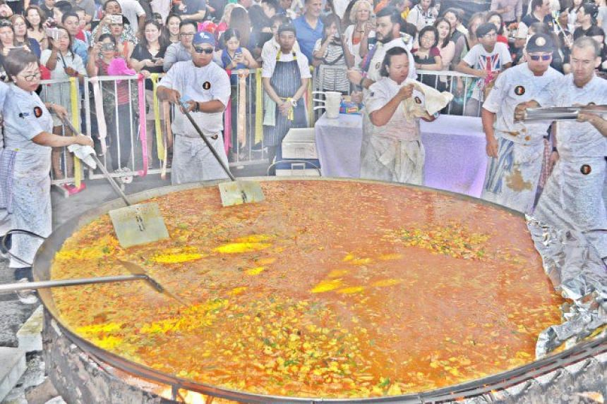 """Paella Gigante,"" an 3.35m diameter paella, complete with chorizo, chicken, and seafood cooked in the traditional way: over charcoal and firewood."