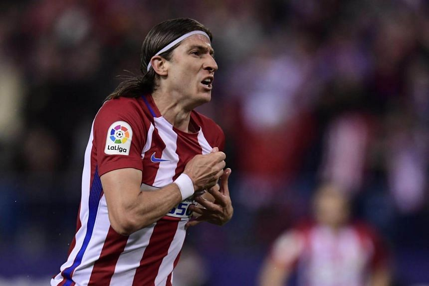 Atletico Madrid's Filipe Luis celebrating after scoring a goal in the win against Real Sociedad.