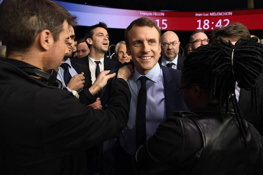 Emmanuel Macron was seen as having the best political programme, according to a snap survey after the TV debate.