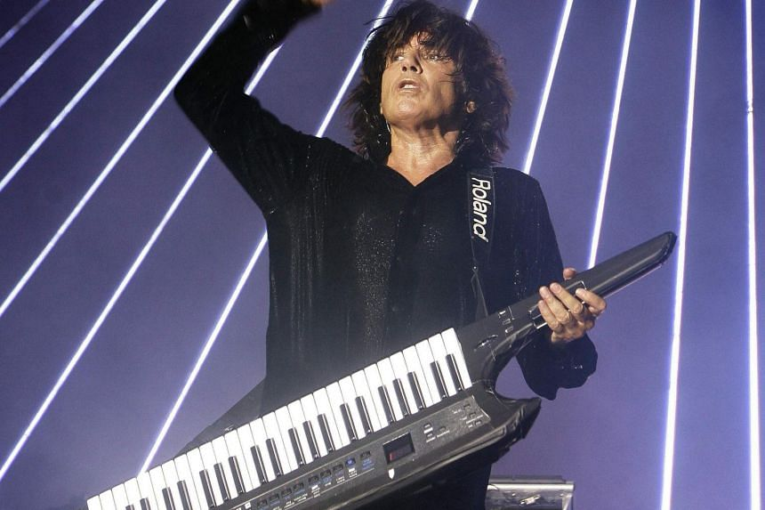 File photo of music producer Jean-Michel Jarre playing a Roland keyboard. Ikutaro Kakehashi, founder of Japanese electronic musical instrument maker Roland which defined much of the sound of 1980s pop, died on April 1, 2017.