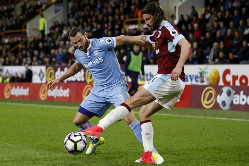 Burnley's George Boyd (right) in action with Stoke City's Erik Pieters in the match on April 4, 2017.