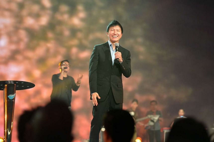 Pastor Kong Hee taking the stage during a City Harvest Church service- the church's first service since he and five other church leaders received their sentences after being found guilty of misusing around $50 million of church monies- at Suntec Co