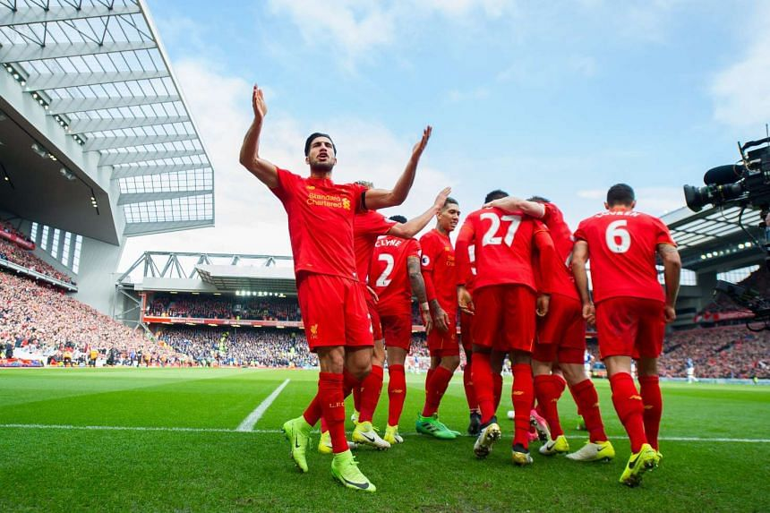 Liverpool's Emre Can (left) and team mates celebrate the 3-1 goal during their derby match against Everton, April 1, 2017.