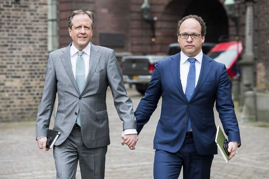 Dutch politicians Alexander Pechtold (left) and Wouter Koolmees held hands outside parliament in The Hague on Monday.