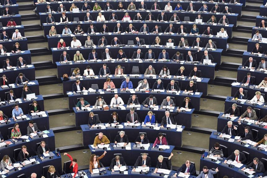 Members of the European Parliament take part in a voting session at the European Parliament in Strasbourg, eastern France, on April 5, 2017.