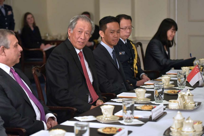 Singapore's Defence Minister Ng Eng Hen (second from left) speaks at the start of a bilateral meeting with US Defence Secretary James Mattis at the Pentagon on April 5, 2017, in Washington, DC.
