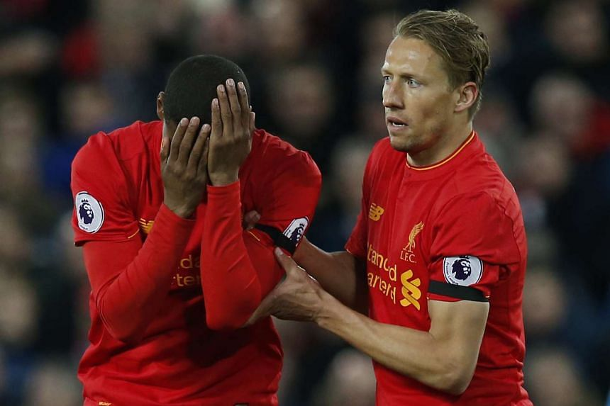 Liverpool's Georginio Wijnaldum looks dejected as Lucas Leiva looks on, after Bournemouth's Benik Afobe scored their first goal.