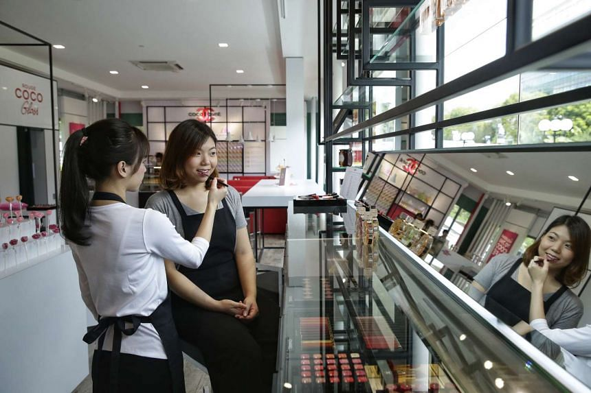Reporter Melissa Heng having her lips done at Chanel's cafe-themed beauty pop-up, Coco Cafe, at Dhoby Ghaut Green.