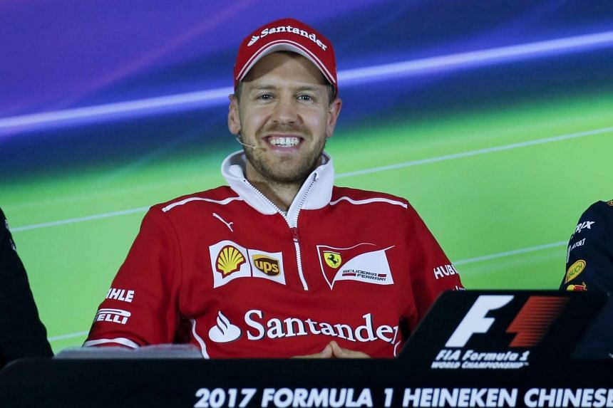 Sebastian Vettel of Scuderia Ferrari smiles during a press conference ahead of the Chinese Formula One Grand Prix at the Shanghai International circuit on April 6, 2017.