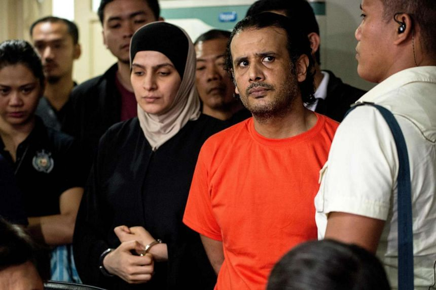 """Kuwaiti national Husayn Al-Dhafiri and his Syrian wife Rahaf Zina had entered the Philippines repeatedly in recent months as part of plans for """"a bombing operation""""."""