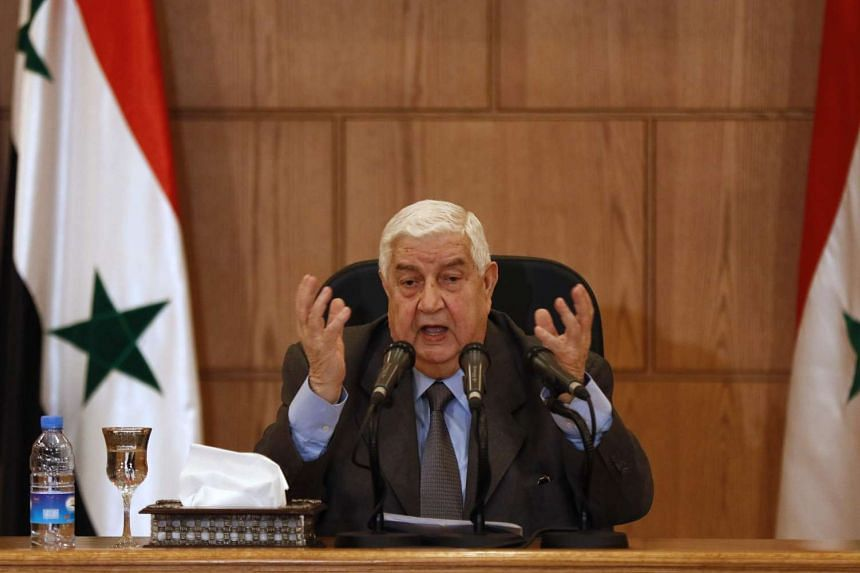 Foreign Minister Walid Muallem speaking to the media at the press conference in Damascus.