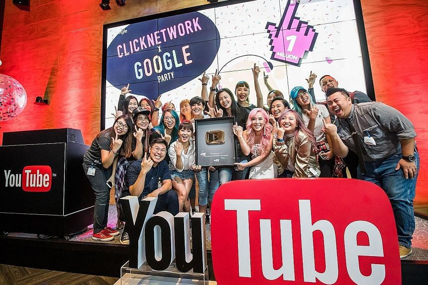The Clicknetwork team with YouTube's Gold Play Button award at Google's Singapore office on Tuesday.