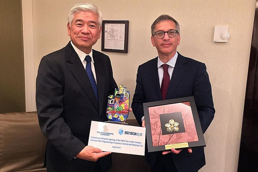 Chief executive of SIAEC Png Kim Chiang (left) and chief executive of Stratasys Ilan Levin signed a memorandum of understanding for the two firms to collaborate on the use of 3D-printed production parts for commercial aviation.