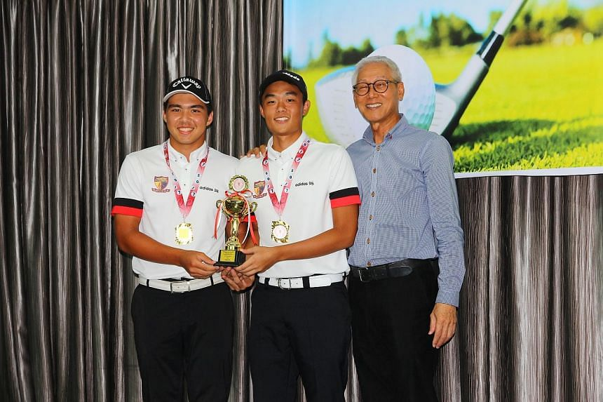 Anglo-Chinese Junior College's Bryan Heinrich (left) and Desmond Kim showing off their trophy after winning the Schools National A Division boys' team title on countback at the Orchid Country Club yesterday. The duo, who pipped Raffles Institution's