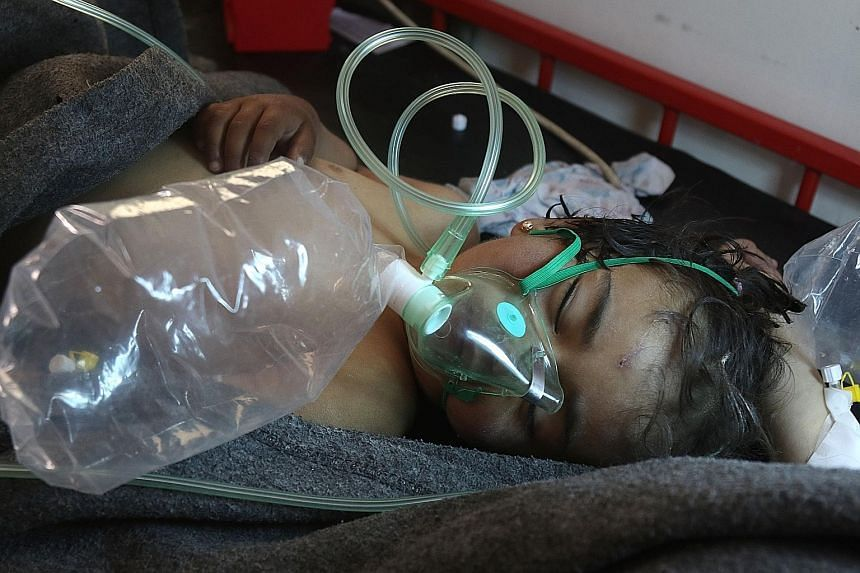 A Syrian child being treated at a small hospital after a suspected toxic gas attack in Khan Sheikhun, a rebel-held town in Syria's north-western Idlib province, as international outrage mounted over the loss of civilian lives. Syrian warplanes have b