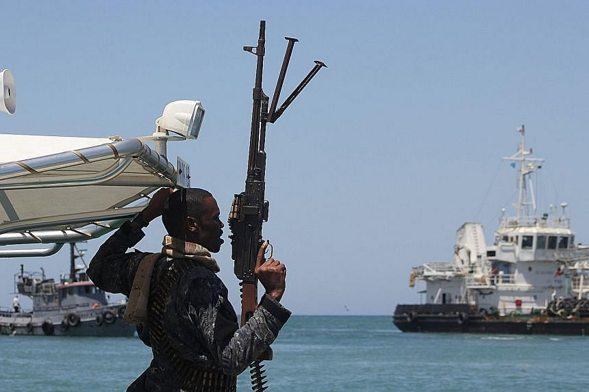 A maritime policeman on alert as an oil tanker released by Somali pirates sailed to Bosasso in Somalia's semi- autonomous region of Puntland last month.