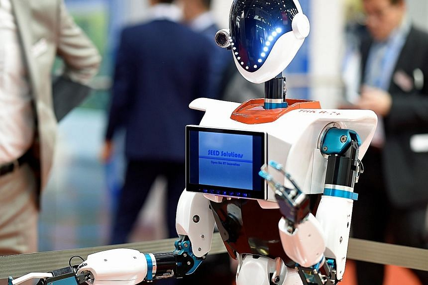 A robot at the Aircraft Interiors Expo 2017 in Hamburg, Germany, this week. A new report says the innovation in artificial intelligence, or AI, and robotics could force governments to order quotas of human workers, upend traditional working practices
