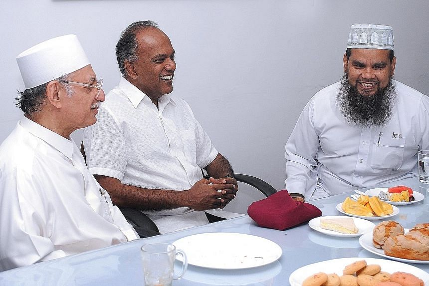 From left: Imam Habib Hassan, Law Minister Shanmugam and Imam Nalla at the Ba'alwie Mosque, where they met for breakfast yesterday together with leaders of the Federation of Indian Muslims and Jamae Chulia Mosque, where Imam Nalla was chief imam. Ima