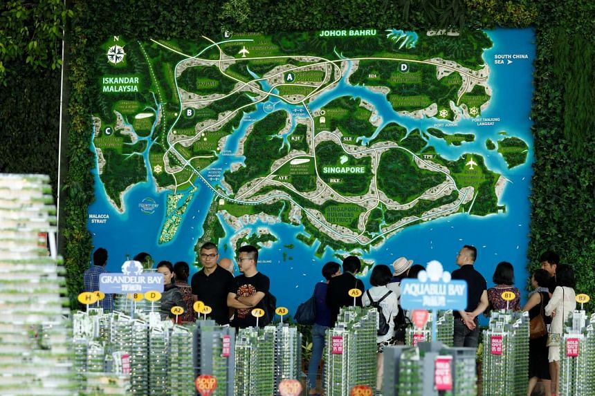 Prospective buyers, made up of mostly mainland Chinese, look at models of condominiums at the Country Gardens' Forest City showroom in Johor Bahru, Malaysia on Feb 21, 2017.