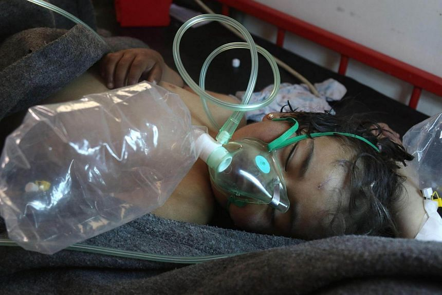 A Syrian child receiving treatment at a small hospital in the town of Maaret al-Noman following a suspected toxic gas attack in Khan Sheikhun, a nearby rebel-held town in Syria's northwestern Idlib province, on April 4, 2017.