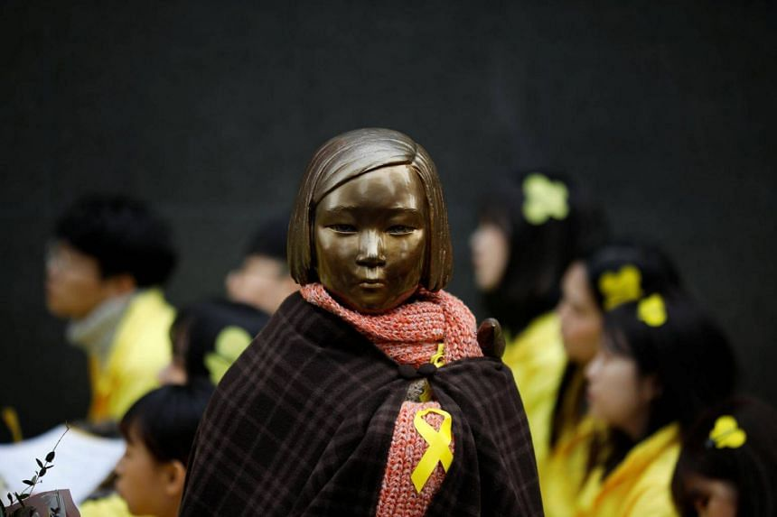 A statue symbolising former South Korean 'comfort women' is seen during an anti-Japan rally on the day of the 98th anniversary of the Independence Movement Day in Seoul, South Korea, on March 1, 2017.
