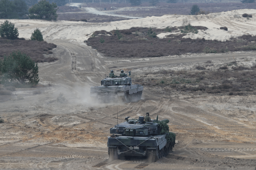 The Singapore Armed Forces' Leopard 2SG Main Battle Tank (MBT) (background) and the Bundeswehr's Leopard 2A6 MBT (foreground) participating in bilateral training as part of Exercise Panzer Strike.