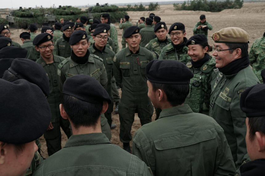 Chief of Army, MG Melvyn Ong (far right), interacting with SAF troops participating in Exercise Panzer Strike.