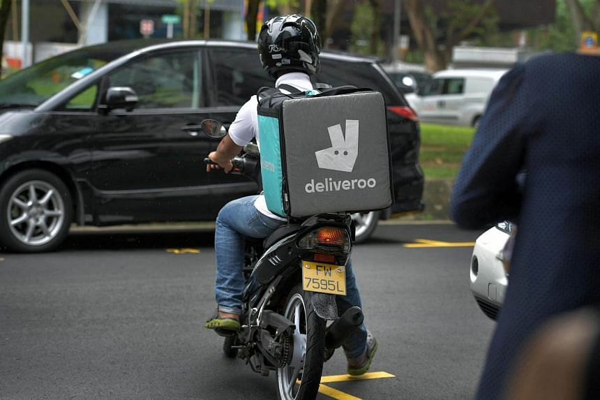 Deliveroo delivery man on his motorcycle along Tras Street on Feb 14, 2017.