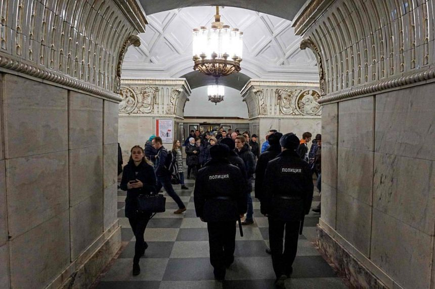 Russian police officers patrol at Prospekt Mira metro station on April 4, 2017 in Moscow, as security measures are tightened following the blast in the Saint Petersburg metro.