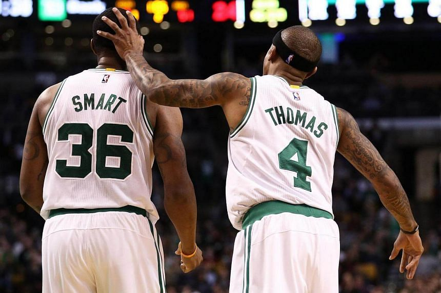 Isaiah Thomas and Marcus Smart of the Boston Celtics in a game against the Milwaukee Bucks at TD Garden on March 29, 2017 in Boston, Massachusetts.