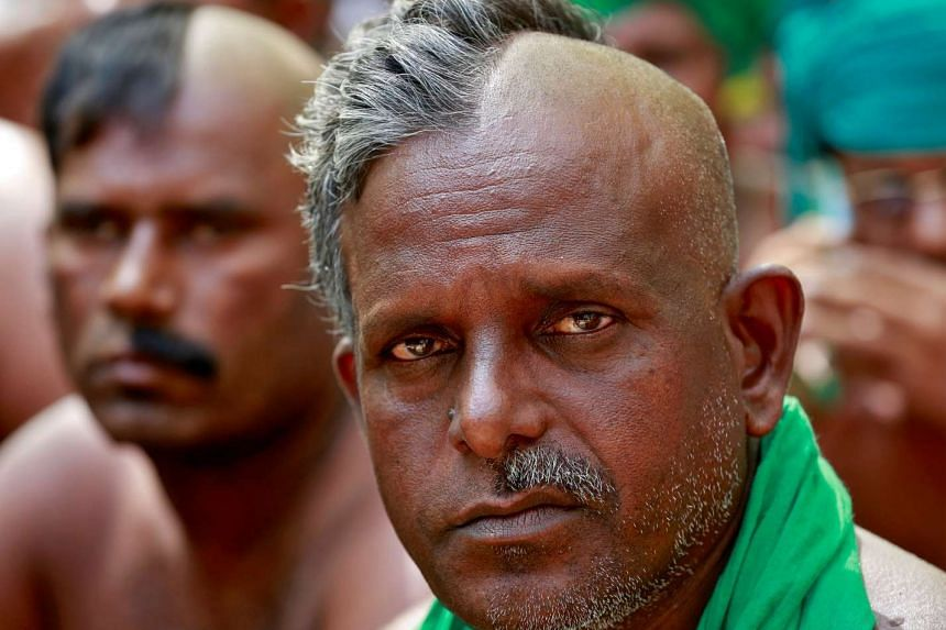 Farmers from the southern Indian state of Tamil Nadu turning up with half-shaved heads for a rally in New Delhi on Monday demanding a drought-relief package from the federal government.