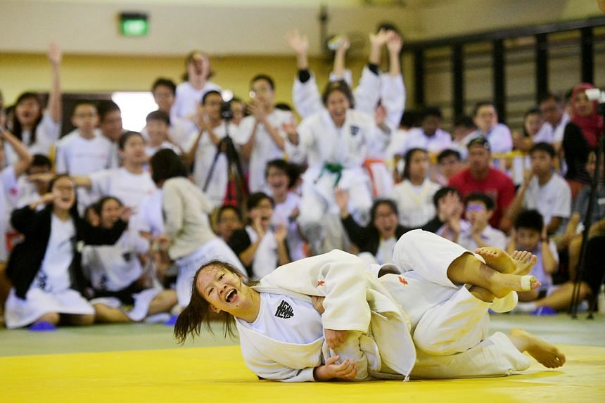 NYGH judoka Wang Jinghan scoring a waza-ari. She beat RGS' Yang Tongchen to help Nanyang win the Schools National B Division girls' title.