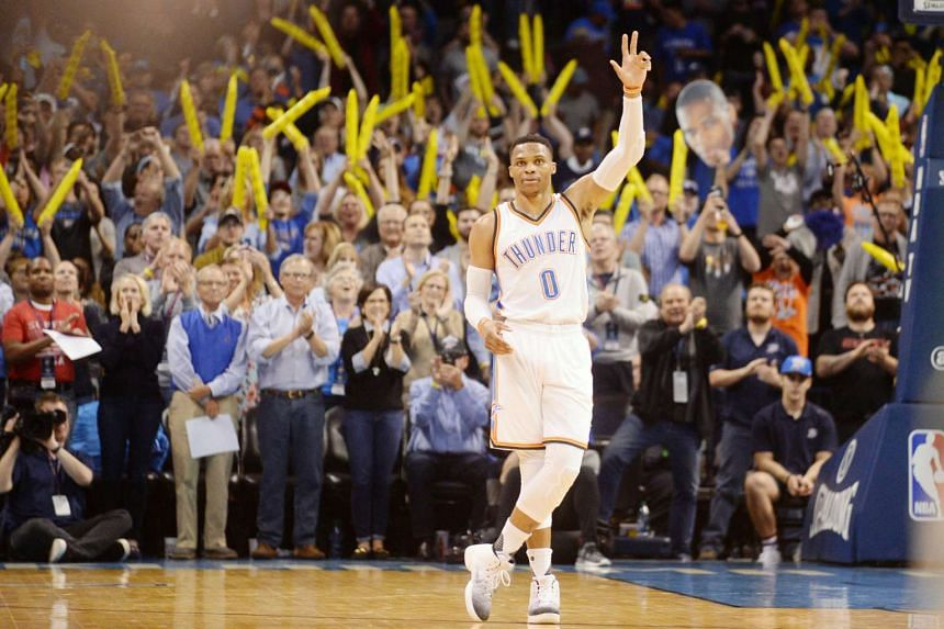 Thunder guard Russell Westbrook reacts as it is announced at Chesapeake Energy Arena that he has tied Oscar Robertson's NBA season triple-double record. His 41st triple-double of this campaign came against the Bucks, scoring 12 points, dishing out 13 assi